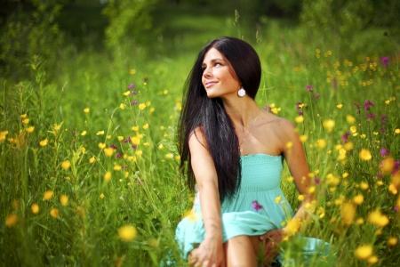 beautiful woman on flower field Stock Photo - 24702273