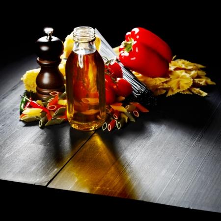 Pasta ingredients on black table, italian cuisine concept photo