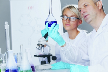Chemistry Scientist conducting experiments in laboratory Stock Photo - 22472774