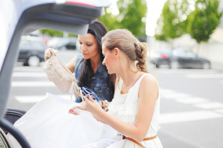 Two woman after shopping photo