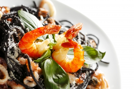 pasta salad: Black spaghetti with seafood isolated on white background