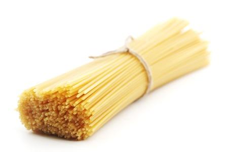 Dry spaghetti isolated on white background photo