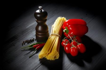 Pasta ingredients on black table, italian cuisine concept Reklamní fotografie