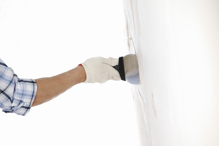 putty: work aligns with a spatula wall