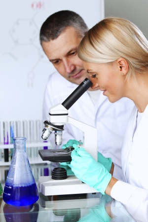 two scientist in chemical lab conducting experiments Stock Photo - 22948898
