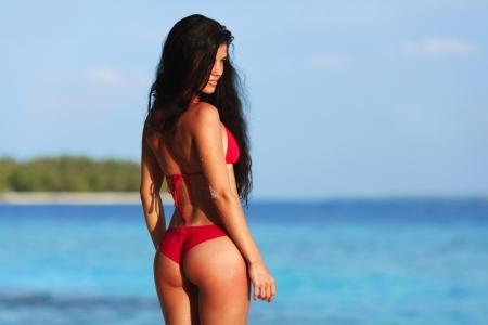 bikini sexy: Beautiful sexy woman in bikini posing on beach Stock Photo