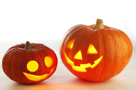 Two funny Halloween pumpkins on white  photo