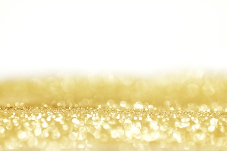 Golden shiny glitter holiday celebration with white copy space