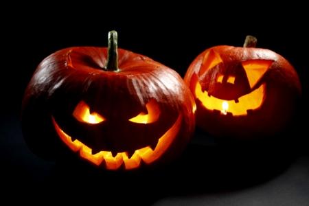 jack o  lantern: Two halloween pumpkins on black background Stock Photo