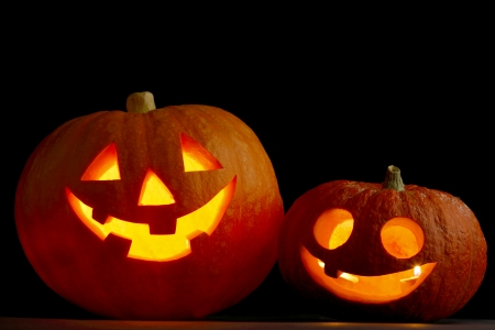 Two glowing Halloween pumpkins  Stock Photo - 22846604