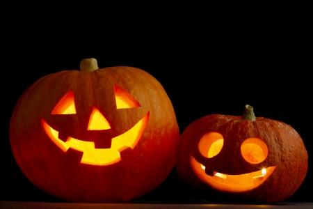 Two glowing Halloween pumpkins Stock Photo - 22846604