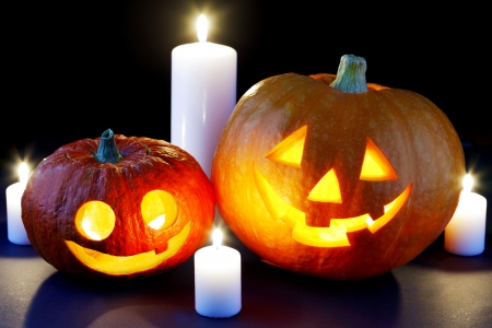 Funny Halloween pumpkins and burning candles photo