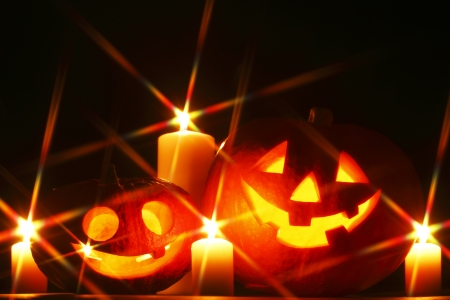 Funny Halloween pumpkins and burning candles Stock Photo - 22846605