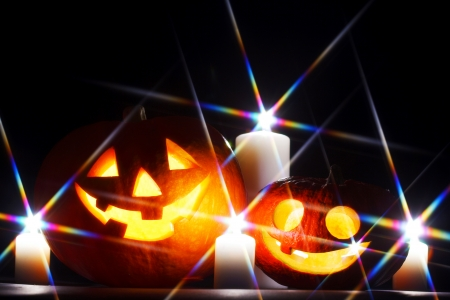 Funny Halloween pumpkins and burning candles Stock Photo - 22775314