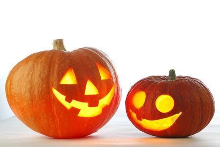 Two funny Halloween pumpkins on white background photo