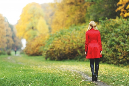 red coats: Rear view of walking  woman in autumn park Stock Photo