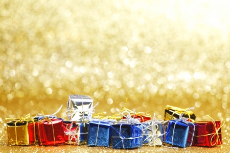 Colorful gift boxes on glitter golden  photo