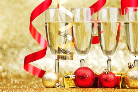 New year champagne and ribbons on golden background photo