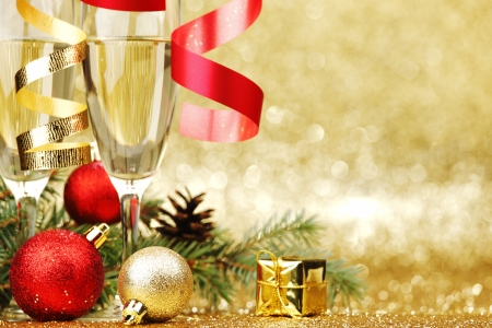 Champagne and new year decoration on golden background photo