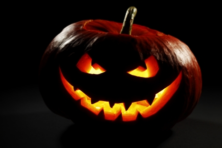 Halloween pumpkin with scary face on black background Stock Photo - 22775463