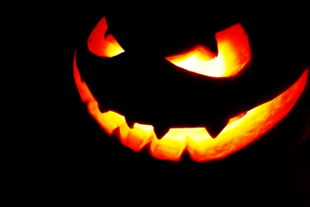 Halloween pumpkin with scary face on black background Stock Photo - 22775465