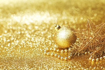 Golden christmas decoration on glitter background photo