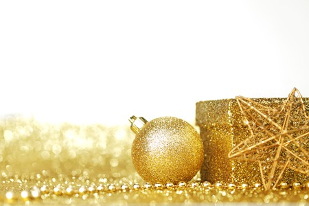 Golden Christmas decoration and gift on shiny background photo