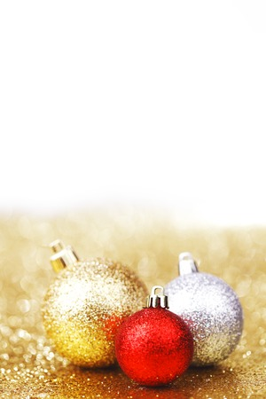 Closeup of Christmas balls on shiny golden background photo