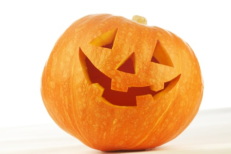 Funny carved Halloween pumpkin on white background photo