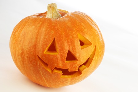 Funny carved Halloween pumpkin on white background Stock Photo