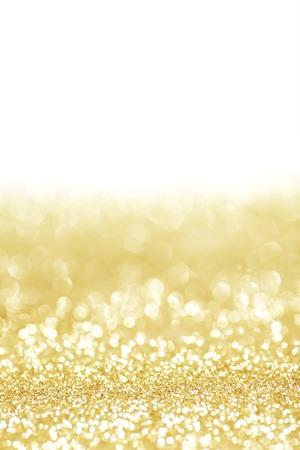 Golden shiny glitter holiday celebration background with white copy space Stock Photo