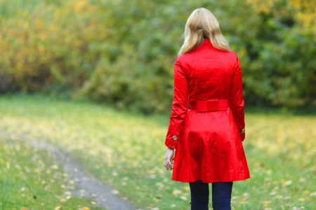 Rear view of walking  woman in autumn park Stock Photo