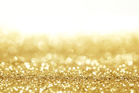 Golden shiny glitter holiday celebration background with white copy space Imagens
