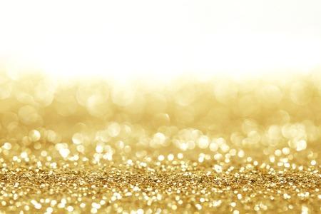 Gouden glanzende glitter vakantie viering achtergrond met witte kopie ruimte