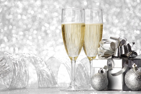 christmas eve: Beautiful silver christmas card with champagne and gift Stock Photo