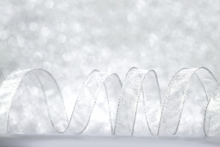 silver ribbon: Curly silver Gift ribbon on shiny background close-up