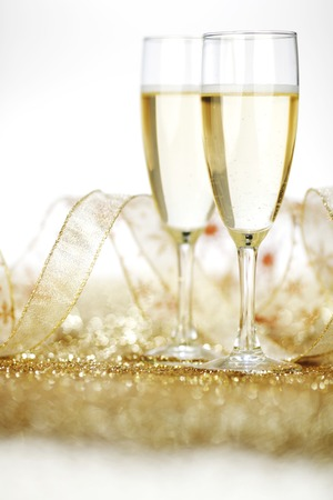 champagne flutes: Two champagne flutes and decoration on gold shiny background