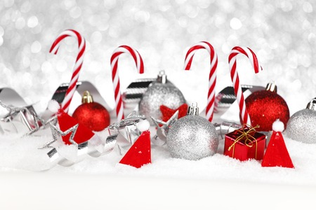 Christmas card with candies and decoration in snow photo