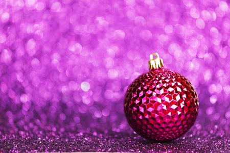 Christmas card with beautiful shiny decoration over purple background