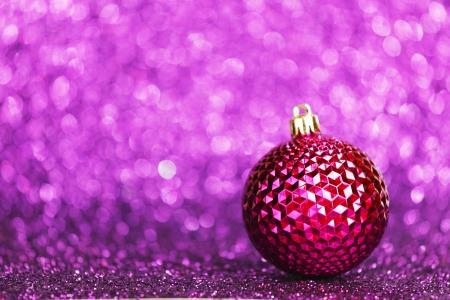 christmas bulbs: Christmas card with beautiful shiny decoration over purple background
