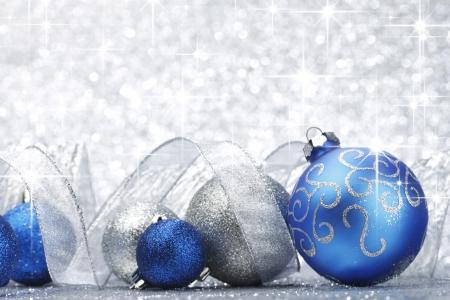 silver ribbon: Blue shiny christmas balls and ribbon on silver glitter stars