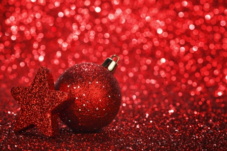 christmas bulbs: Christmas card with beautiful shiny decoration over red  Stock Photo