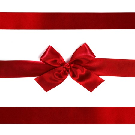 Red ribbon with bow isolated on white  photo