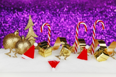 Christmas card with colorful decoration over purple background photo