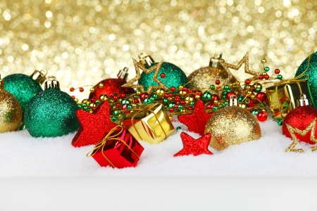 Colorful Christmas decoration and gifts on snow photo