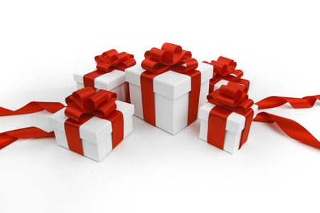 Gift boxes with red bow isolated on white background photo