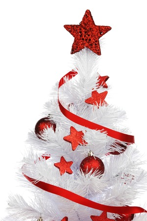 Christmas tree with red decoration isolated on white background photo