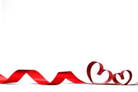 白、バレンタインの日の概念にハート形のリボン 写真素材