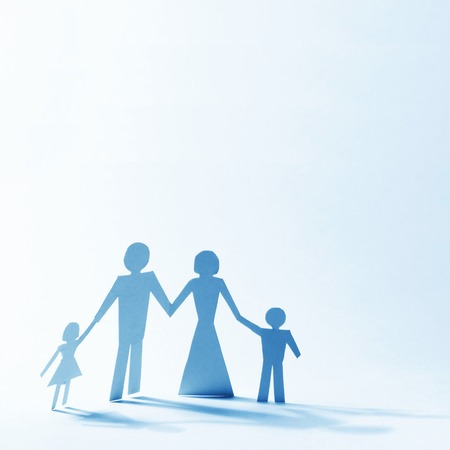 Paper family linked together over light background photo