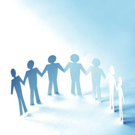Paper people linked together unity concept Stock Photo - 25670493